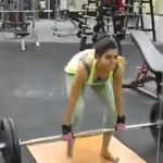Samantha  weightlifting in gym